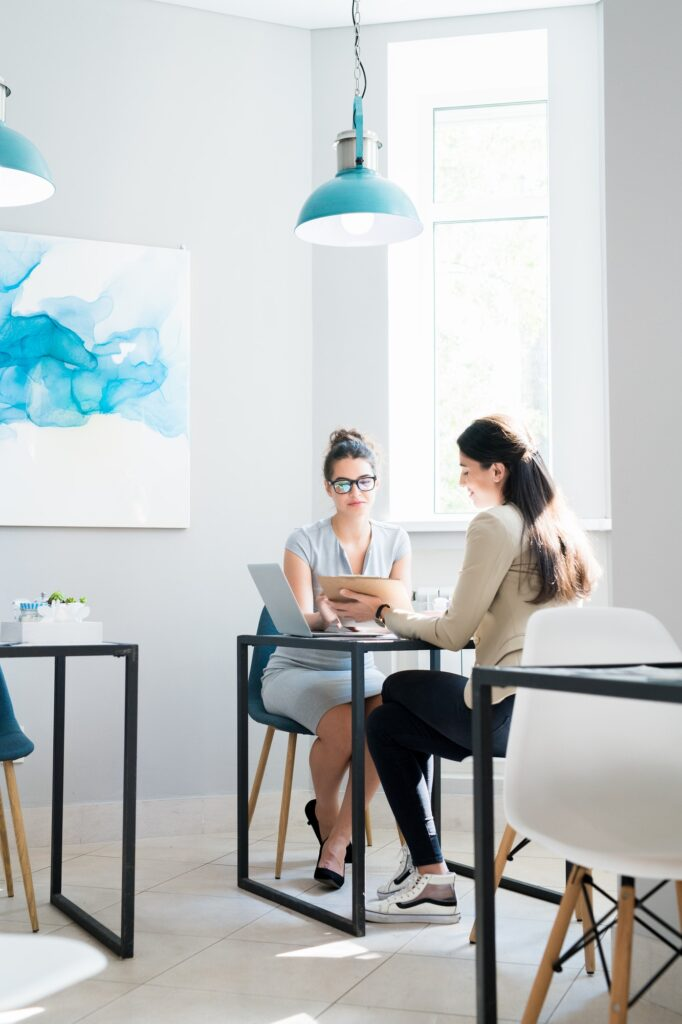 Two Businesswomen Meeting in Cafe